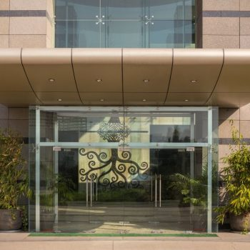 main entrance of the quark city building in which the maracana SDC Private Limited office is